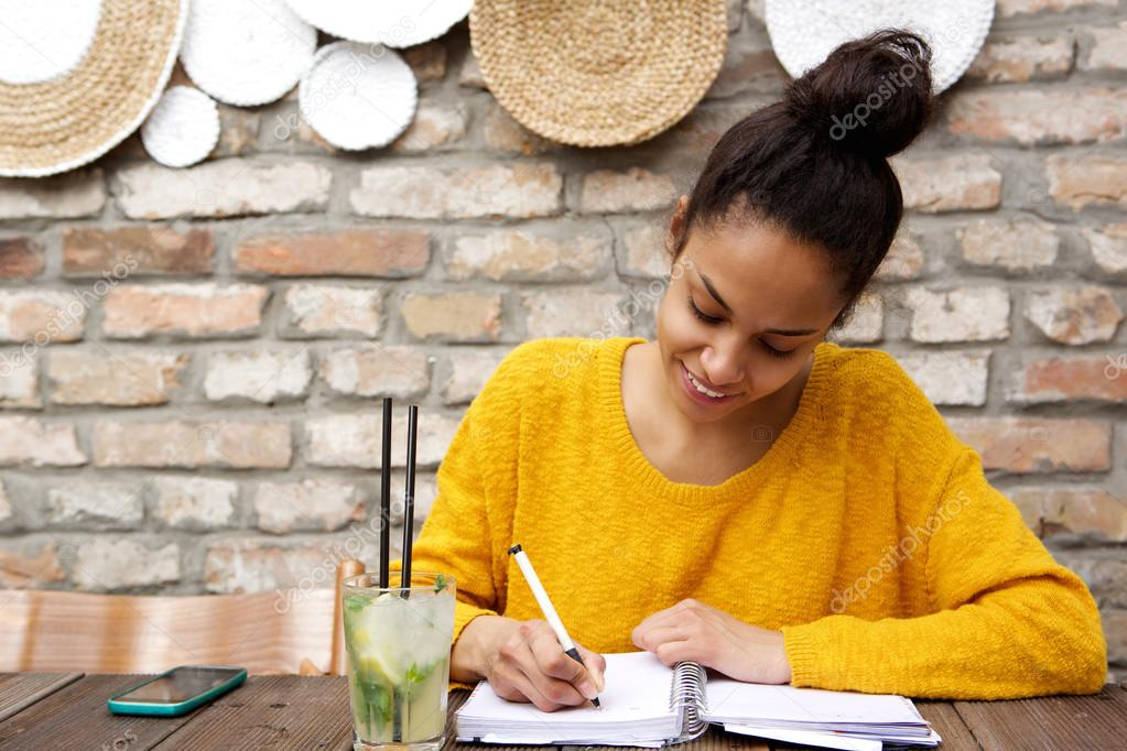 Beautiful young black woman writing notes stock photo beautiful young black woman writing notes stock photo publicscrutiny Gallery