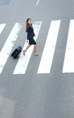 Businesswoman walking with travel bags