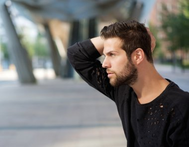 Male fashion model posing with hand in hair