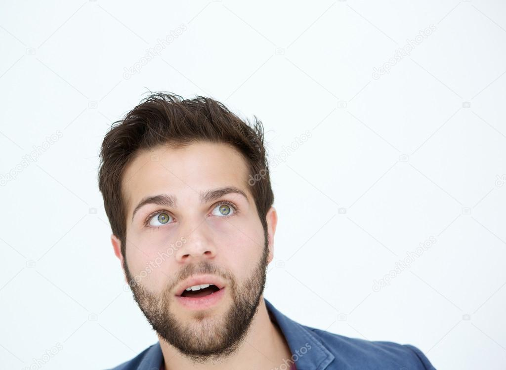Young man looking up with surprised expression
