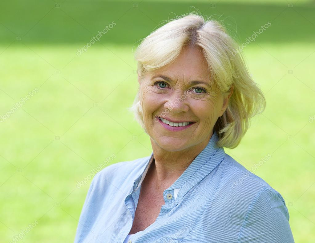 Older woman smiling outside