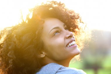 Young african american woman smiling and looking up