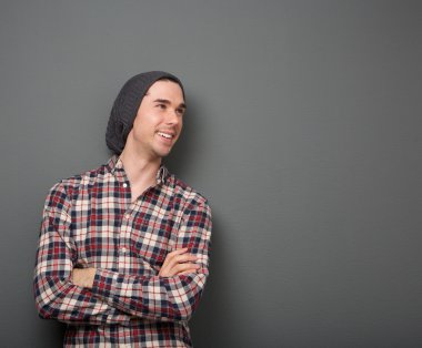 Cheerful young man in checkered shirt