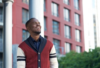 Happy black man smiling in the city