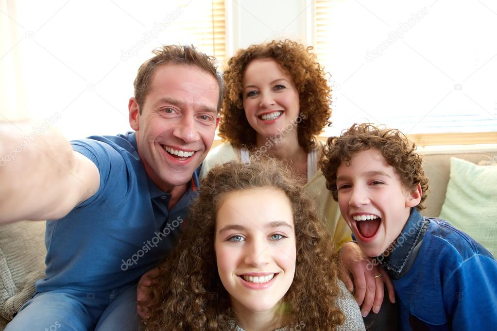 Happy family taking a selfie at home