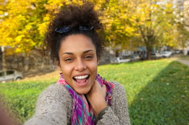 Selfie portrait of a happy young woman