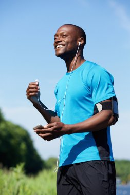 African american male runner smiling