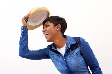 Smiling african american woman holding hat