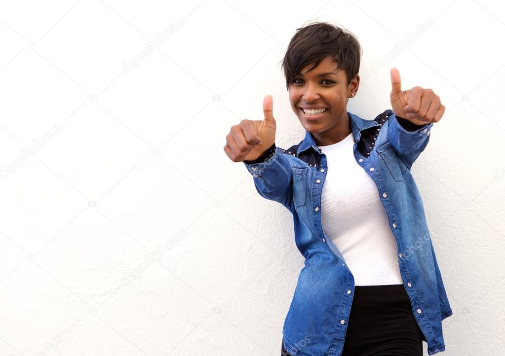 Smiling african american woman with thumbs up