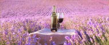 Bottle of wine against lavender.