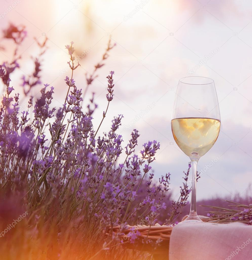 Wine glass against lavender.