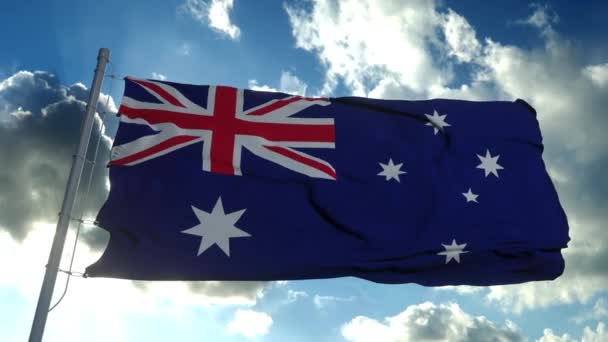 The national flag of Australia blowing in the wind against a blue sky