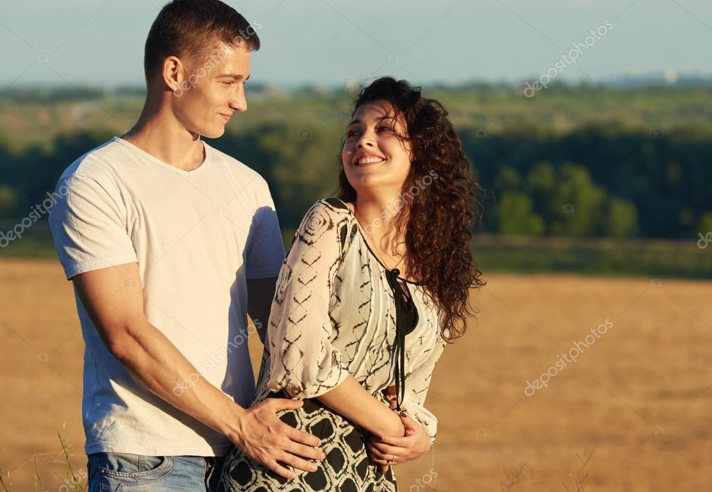 Happy Young Couple Posing High On Country Outdoor Romantic People