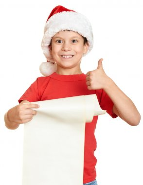 boy in red hat with long scroll wishes to santa - winter holiday christmas concept