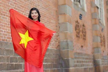 Happy patriotic young Vietnamese woman