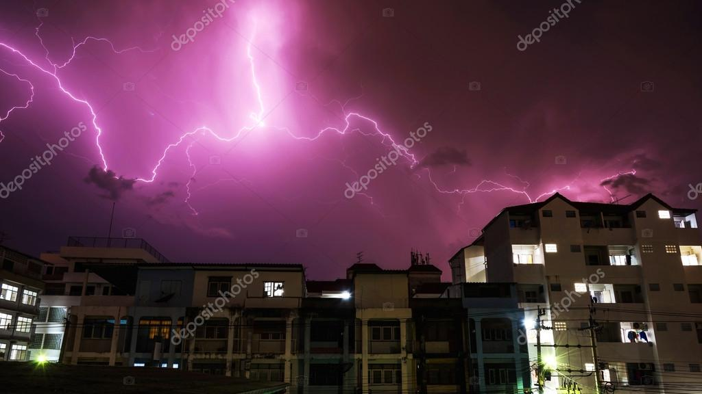 Heavy lightning storm over urban building