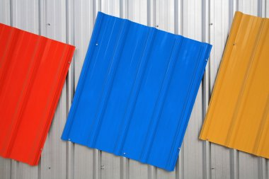 Metal roof painted by red, blue, yellow