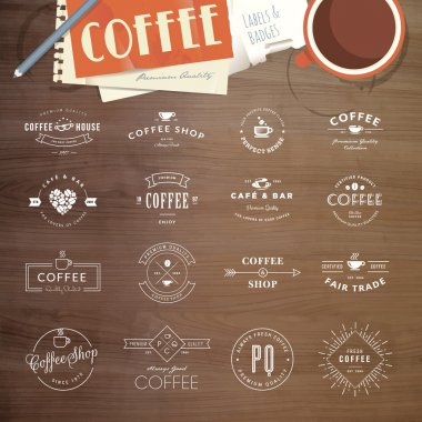 Set of vintage style elements for labels and badges for coffee, with wood texture, cup of coffee and a notepad in the background