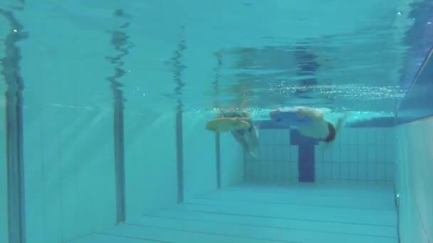 Underwater children in aquapark