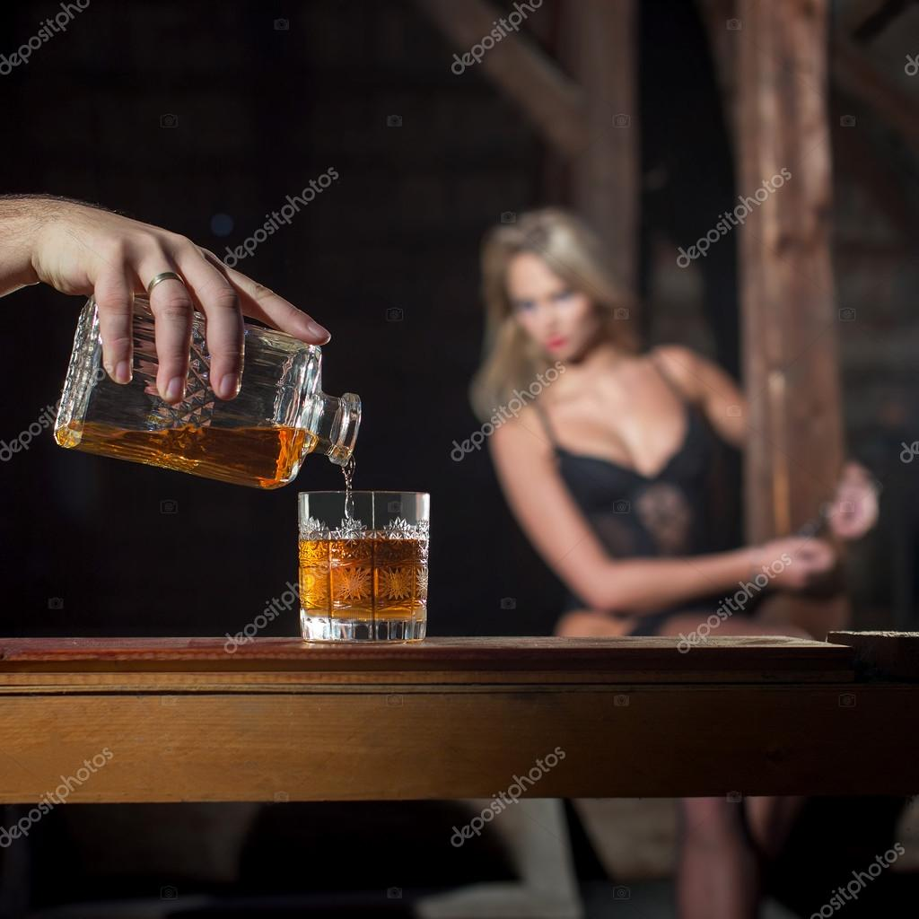 Man pour whiskey for lover