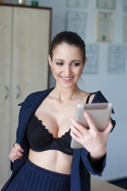 Sexy ceo in bra and tablet