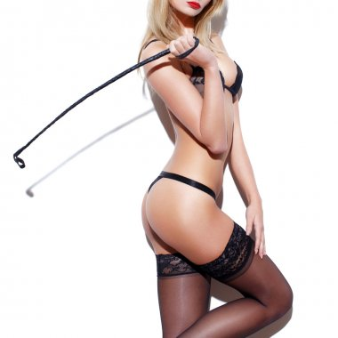 Sexy woman body with whip