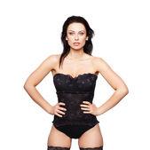 Sexy Frau im Korsett zu posieren, isoliert