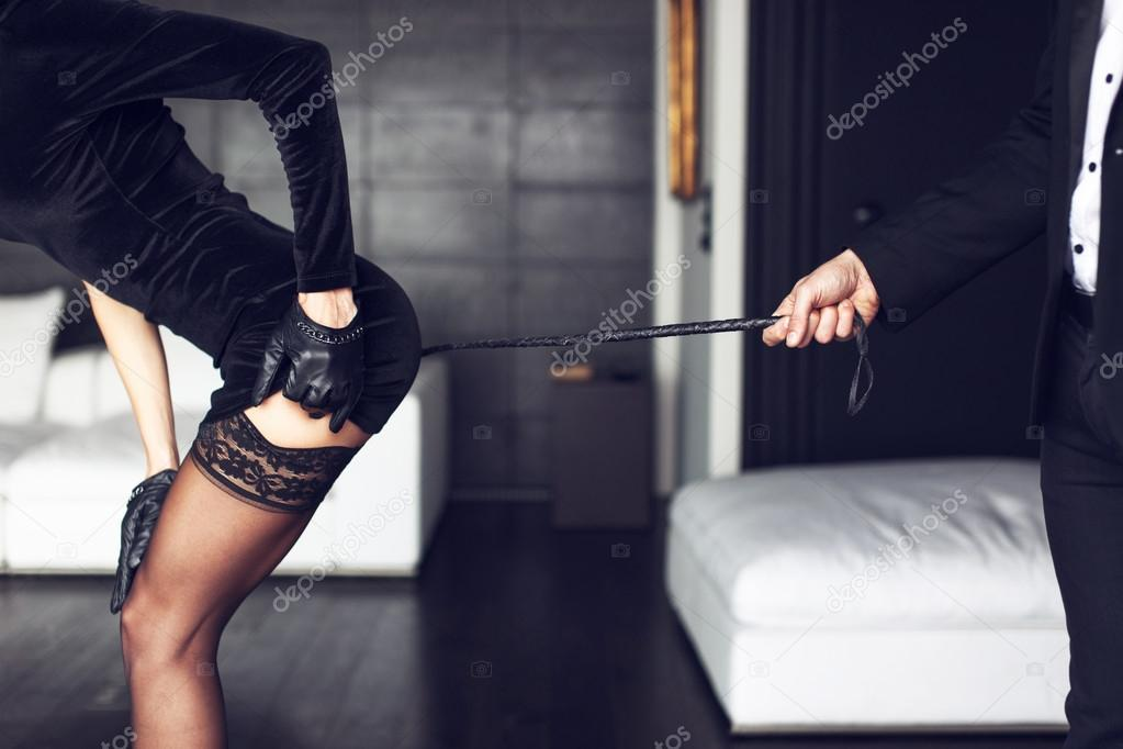 Sexy rich woman with whip on ass bdsm