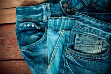 Blue jeans pocket  on wooden background