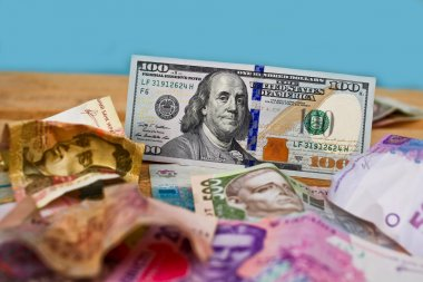 Dollars  and crumpled scattered Ukraine money