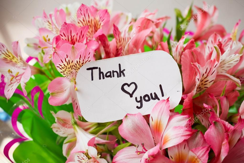 bouquet of flowers and card with lettering thank you — Stock Photo ...