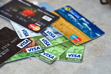 KIEV, UKRAINE - on June 15: Heap of credit cards, Visas and MasterCard,, Ukraine, on june 15, 2015.Pile of Visa credit cards. Visa and master card is biggest credit card.