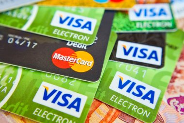 KIEV, UKRAINE - on June 15: Heap of credit cards, Visas and MasterCard,, Ukraine, on june 15, 2015.Pile of Visa credit cards. Visa and master card is biggest credit card.