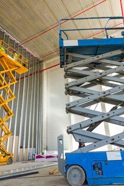 Scissor lift platform on a construction site.