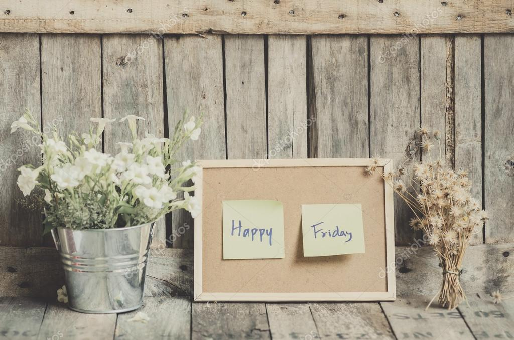 Vintage style effect Happy Friday message on corkboard with flow