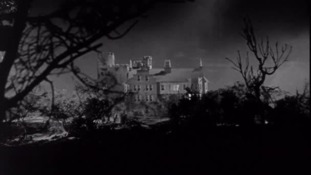 Exterior of mansion at night