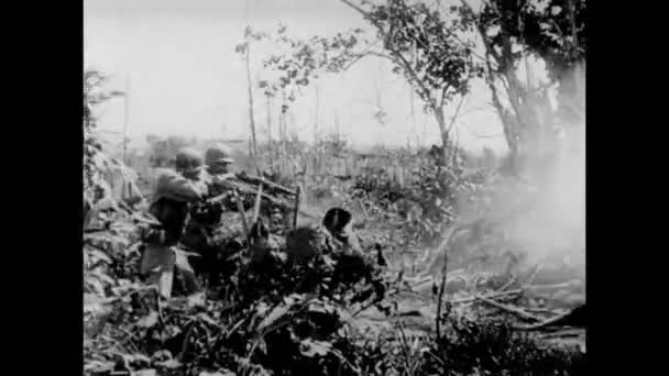 Soldiers firing into bushes