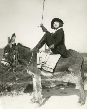 Bareback riding. Woman riding  Donkey stock vector