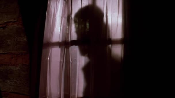 Person through curtains knocking on door