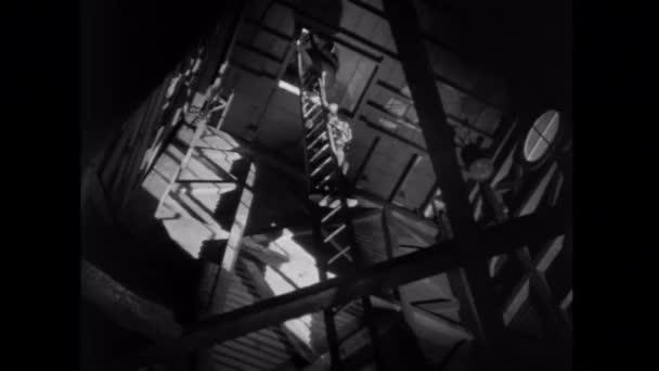 Man losing balance on ladder