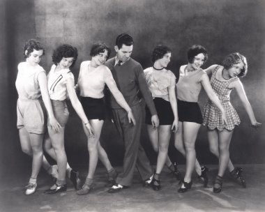 Choreographer rehearsing with dancers
