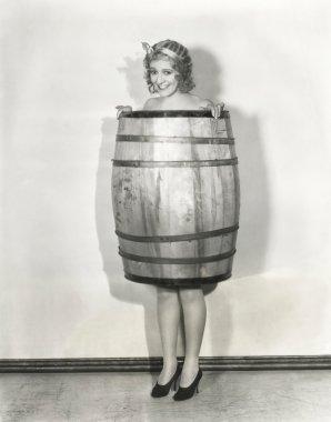 Woman holding barrel