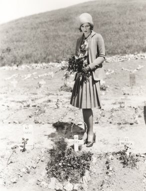 woman visiting Pet cemetery