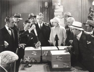 men unpacking boxes