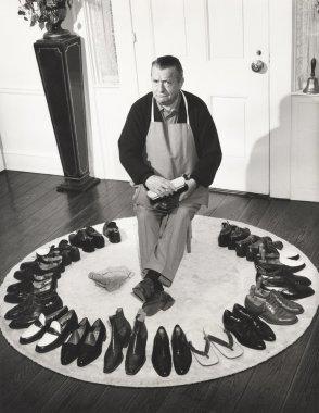 mature man brushing shoes