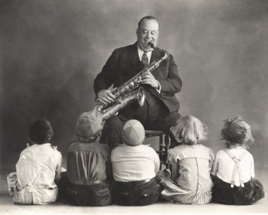 man giving Saxophone lessons