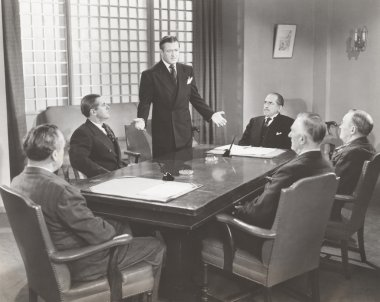 businessmen talking in board room