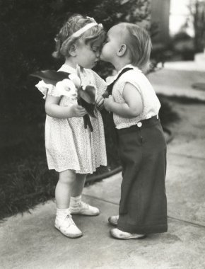 Cute boy kissing girl
