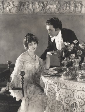 man and woman dining