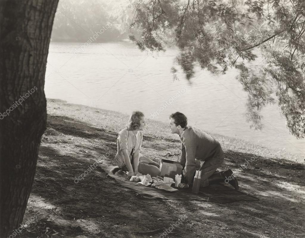 man and woman having   picnic